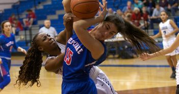 Lady Lobo Samirah Cunningham (left) attempts to rip possession of the ball away from Westlake Chaparral Sydney Davis (15) during Friday's district tilt at the Lobo Den. (photo by Moses Leos III)