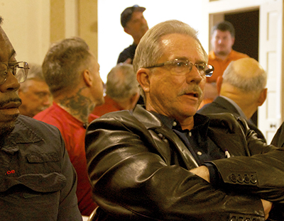 Residents listen to heated discussion at the Uhland City Hall meeting over State Highway 21 on Jan. 18. (photo by Moses Leos III)