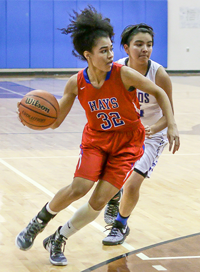 Hays Rebel senior guard Breajee McMillian (32) readies to drive into the paint during the team's district contest against the Lehman Lobos at the Lobo Den Jan. 6. (photo by Moses Leos III)