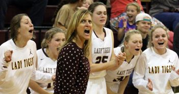 Dripping Springs Head Coach Laura Joiner looks at the scoreboard and yells with delight as the Lady Tigers' bench celebrates after Madison North closed the gap on Marble Falls, 46-40, from the free throw line with 55.6 seconds in the final period. (photo by Wayland D. Clark, wfotos.com)