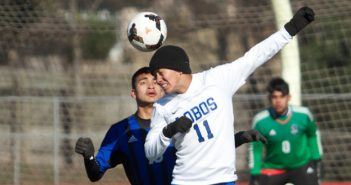Lehman Lobo sophomore forward Santos Hernandez Zurita (11) quite literally uses his head when it came to making a play in the Lobos' consolation final match against the Cedar Creek Eagles at Shelton Stadium Jan. 7.(photo by Moses Leos III)