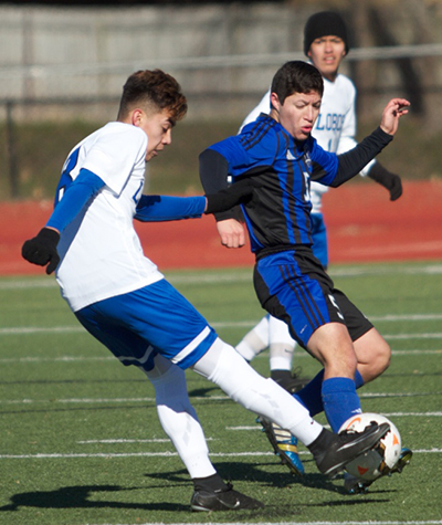 A Lobo player fights for the ball against a Cedar Creek Eagle at Shelton Stadium Jan. 7.(photo by Moses Leos III)