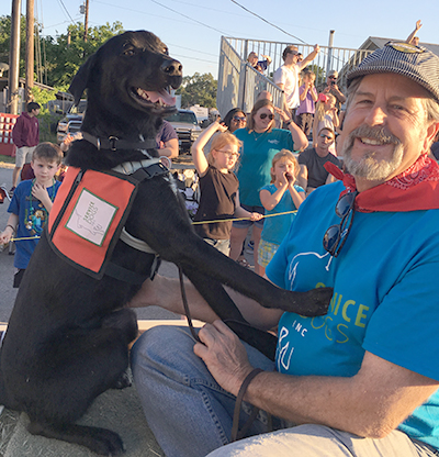 Director of Training Al Kordowski and service dog Anakin on the Service Dogs, Inc. float at the 2016 Founders Day Parade. (photo courtesy of Service Dogs, Inc.)