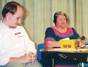 Former Hays Free Press editor Jon Schnautz moderates a debate between Tommy Poer and BSEACD board member Jim Camp. (Hays Free Press file photo)