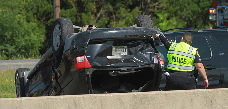 Authorities seek man who fled I-35 rollover wreck