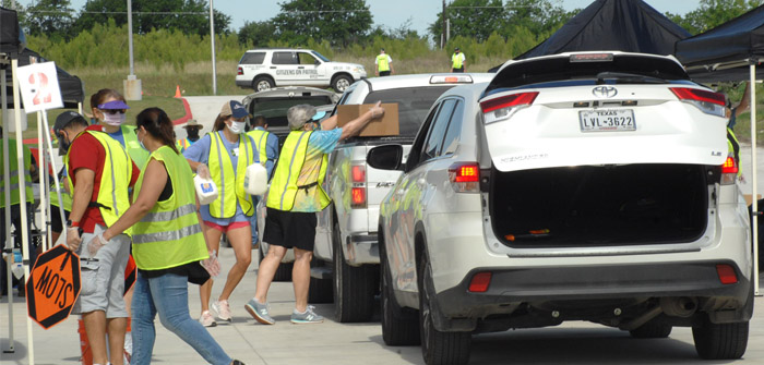 Families receive free food during Kyle distribution event